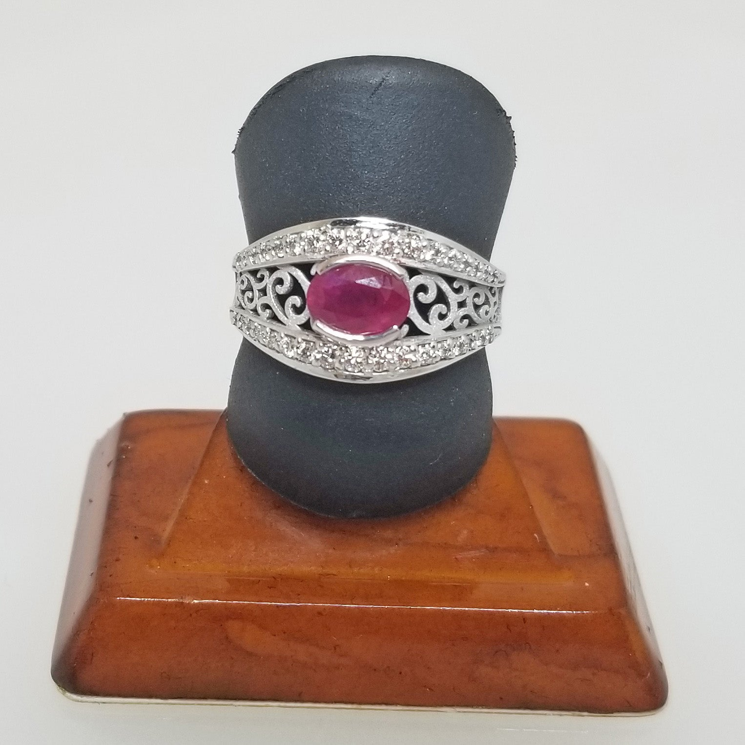 Ready to ship ruby and diamond scroll ring in 14k white gold