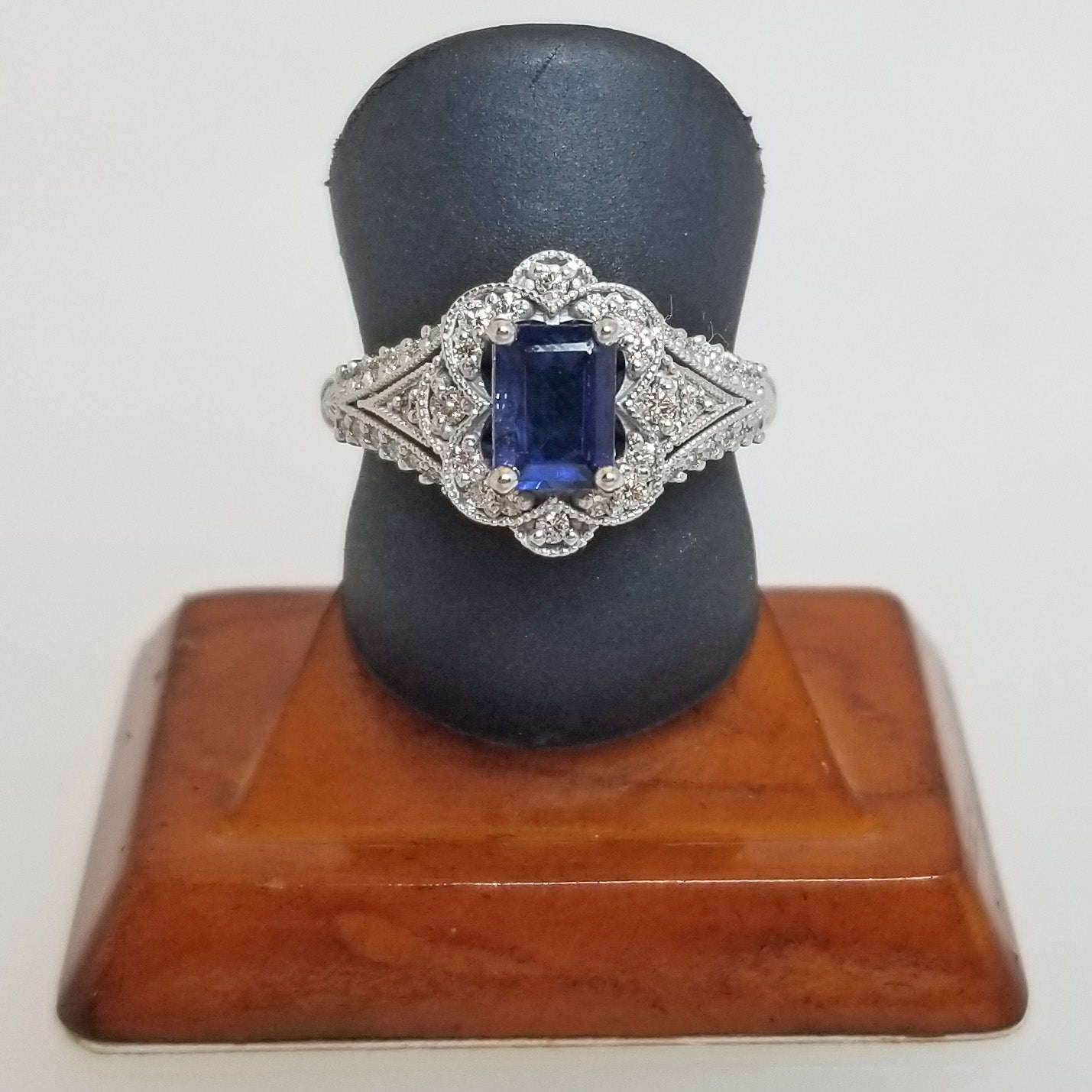 Ready to ship blue sapphire and diamond emerald cut ring with scallop halo in 14k white gold