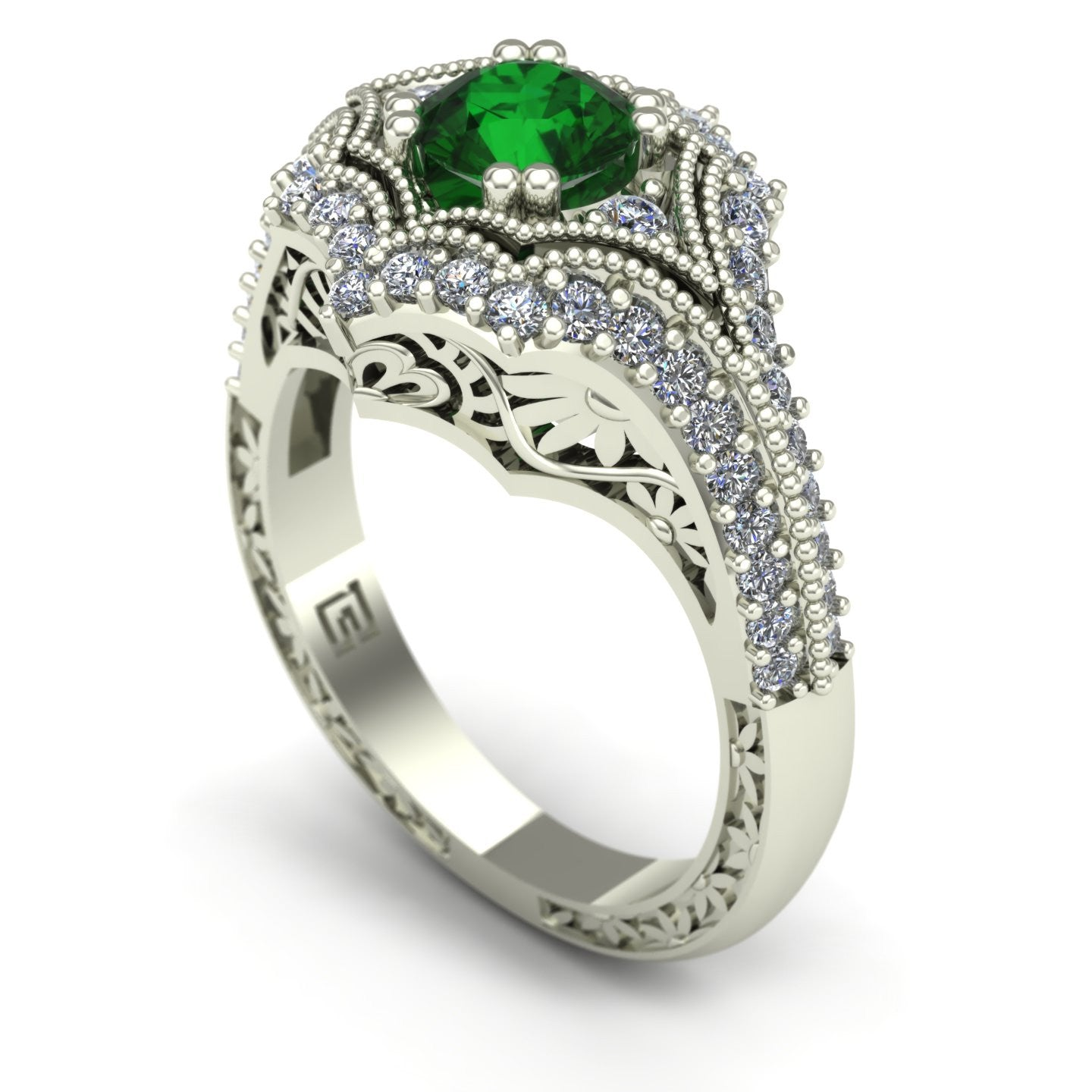 Emerald and diamond ring with floral carving in 14k white gold