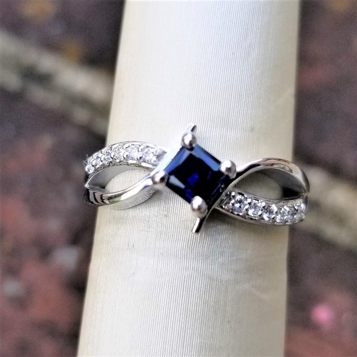 Ready to Ship princess cut lab created blue sapphire bypass ring in 14k white gold