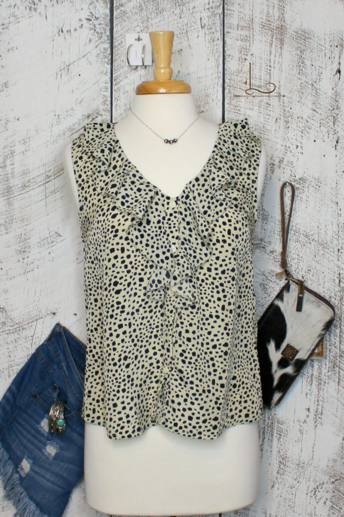 Dotted Sleeveless - L Trading