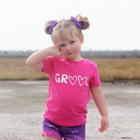 "child wearing pink tee shirt ""grool"""