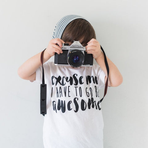white shirt with black design 'excuse me i have to go be awesome'