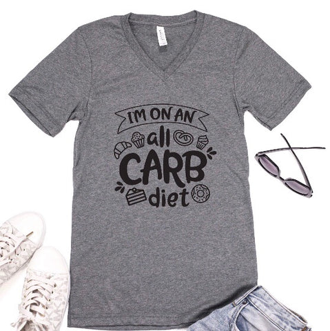 grey shirt that says 'i'm on an all carb diet' black writing and food graphics around it