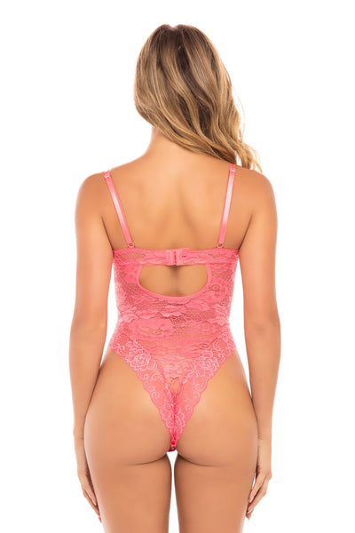 a size small white woman stands with her back to the camera wearing a floral lace bodysuit in a pretty coral color. The teddy is cheeky cut with a hook and eye closure mid-back and a keyhole just below the closure.