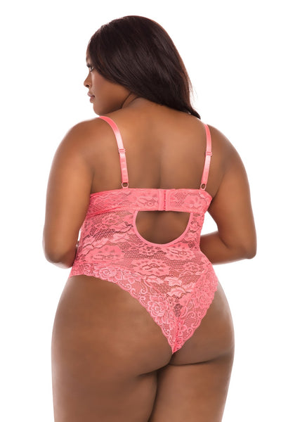 a plus size black woman stands with her back to the camera wearing a floral lace bodysuit in a pretty coral color. The teddy is cheeky cut with a hook and eye closure mid-back and a keyhole just below the closure.