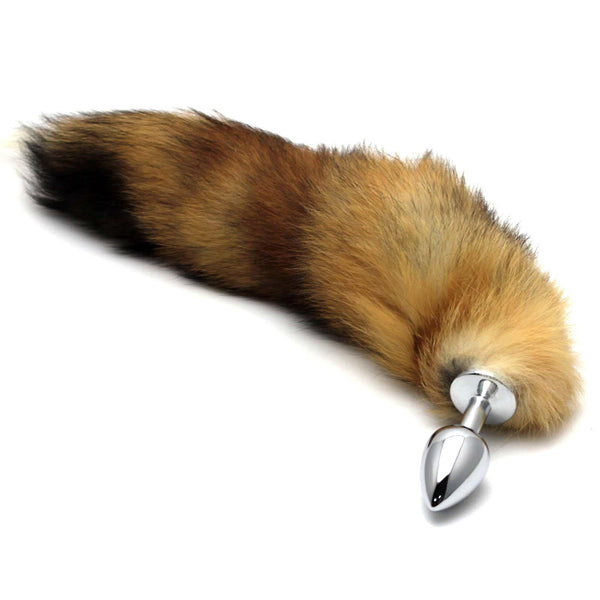 Redish brown ombre faux fur fox tail and butt plug. The vegan fur tail is connected to a base, making it safe for anal play.