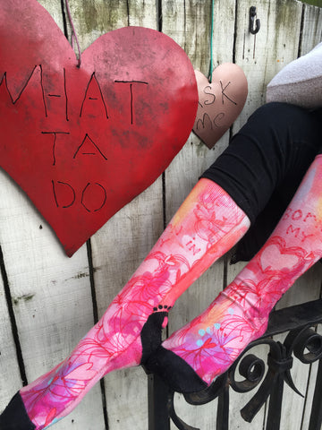 Woman wearing custom Born in Your Heart SoleMate Sox from artist Stephanie Corfee