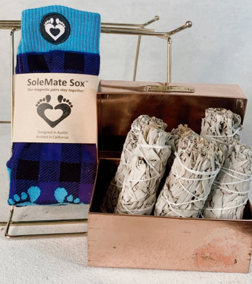 Purple Plaid SoleMate Sox pictured with White Sage smudge sticks in a copper box from Rawkstar Living in Ada, Oklahoma