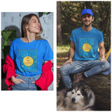 "A collage of a woman and also a man with a dog; both wearing our unisex ""Be The Light"" T-shirt on color 'Carolina Blue'. T-sh"