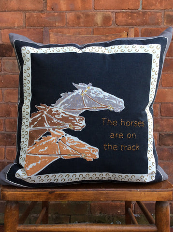 """The Horses are on the Track"" embroidered pillow"