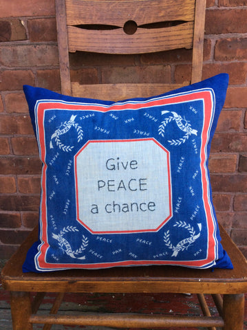 """Give Peace a Chance"" embroidered pillow"
