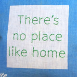 """There's no place like home"" embroidered pillow"