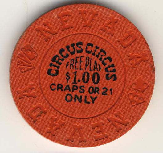 Circus Circus $1 free play craps or 21(orange 1970s) Chip