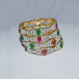 Set of 4 Bangles of Tanzanian Zircon with Ruby and Green Stones
