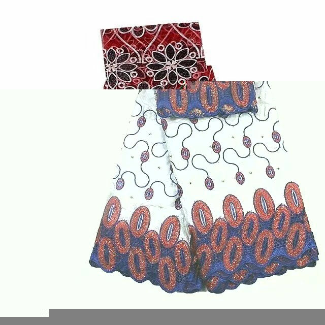 FL0001- White Brocade Fabric with Blue and Red Design