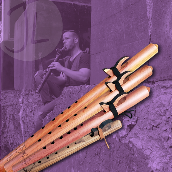 Affordable cedar Native American flutes stacked along side each other against the blue sky
