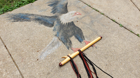 Eagle made from chalk carrying a native american flute