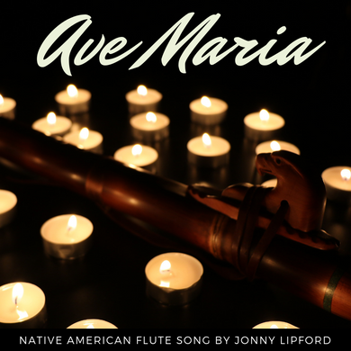 Native american flute sitting around tealight candles to be the cover of the song Ave Maria