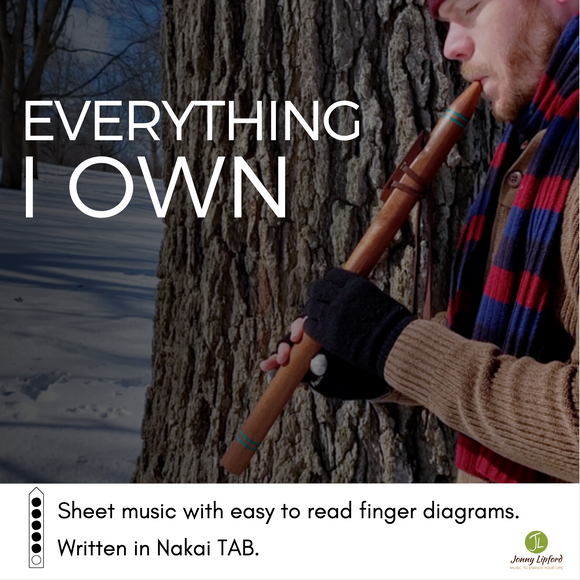 Jonny Lipford standing in front of a tree playing a Native American flute. This is the cover image for the Native American Flute Sheet Music to Everything I Own