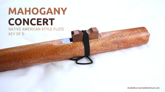 A side view of a deep sounding Native American flute made from Mahogany sitting on a white background. This concert Native American Flute is available to play at Jonny Lipford Music dot com