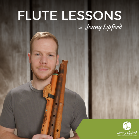 Jonny Lipford standing with his Native American flutes, posing for Native American flute lessons