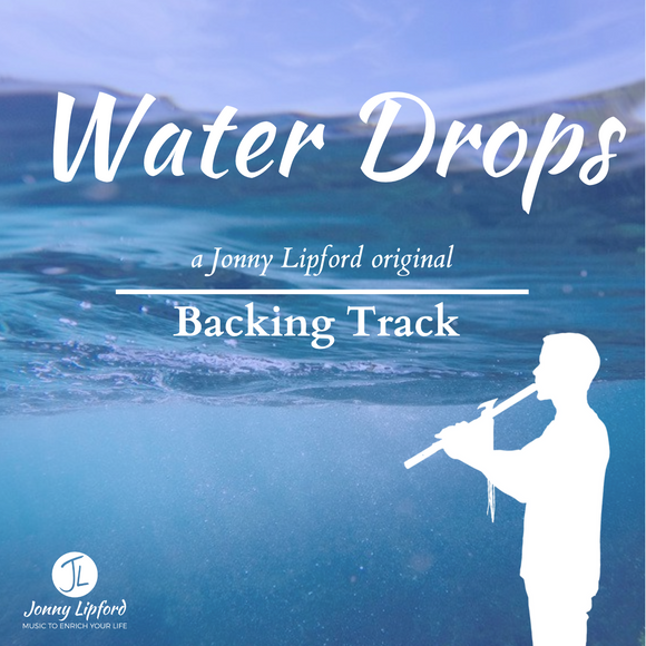 Jonny Lipford standing in front of water playing his Native American flute. This is the feature image for the product Native American Flute Backing Tracks