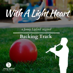 Jonny Lipford silhouette playing his native american flutes in front of a red ball on the playground. This is the product image for With A Light Heart Backing Tracks for Native American flutes.