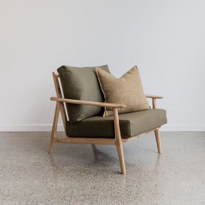wool arm chair and linen cushion from corcovado furniture new zealand