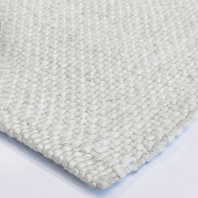 white large floor rug mat in wool from corcovado furniture acuckland new zealand