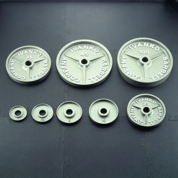 Complete line of Ivanko OM Series machined barbell plates