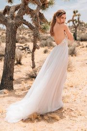 Boho lace wedding dress with anemone embroidered lace and illusion tulle.