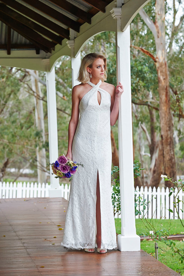 Sexy halter wedding dress with a fitted silhouette and front split.
