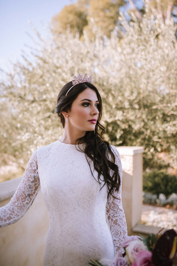Samantha Wynne Georgia is a lace wedding dress with long sleeves and a high neckline.