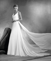 Our Pronovias Atelier Einara gown is a gorgeous silk chiffon empire wedding dress.
