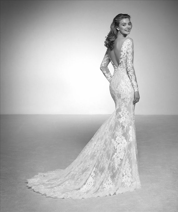 Pronovias Iman is a tulle wedding dress with chantilly and guipure appliqués with sparkly beading.