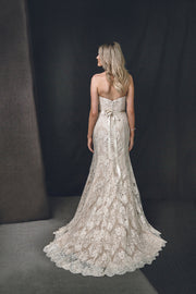 Wedding dress with French lace, sweetheart neckline and scallop edge train.