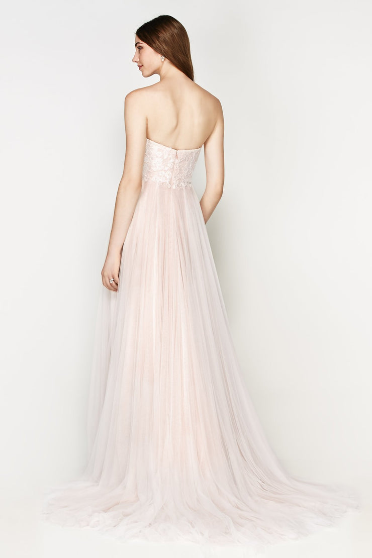 Watters Rorain is a wedding dress with a sweetheart neckline and tulle skirt.