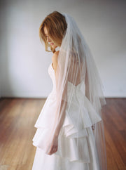 The Samantha Wynne Stacey Veil is a beautiful soft English two-tiered tulle veil.