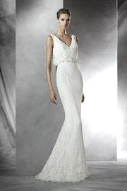 Pronovias Preslie is a stunning ivory lace V Neck wedding dress.