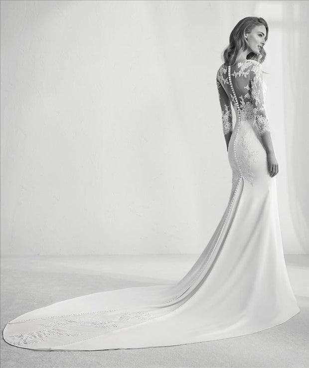 Pronovias Ragazza is a beautiful wedding dress with lace tattoo effect and tulle and gemstone back.