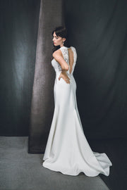 A halter neck wedding dress with sheer lace panel insert detail on both front and back.