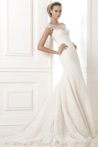 Pronovias Kairos is a lace wedding dress with gemstone embroidery and tulle.