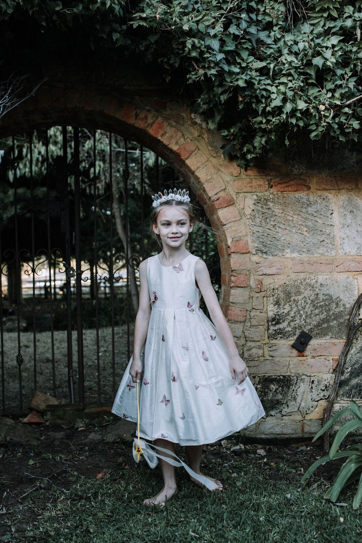 Samantha Wynne Lare is a beautiful silk flower girl dress adorned with butterflies.