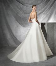 Pronovias Torsa is a simple, strapless princess wedding dress in mikado.