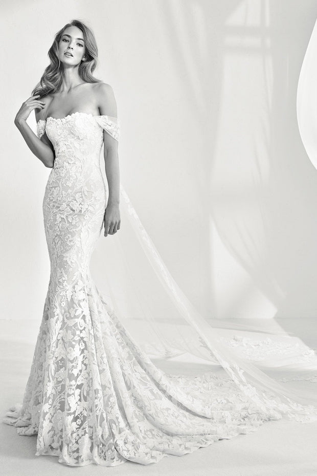 Lace mermaid style strapless wedding dress with cape