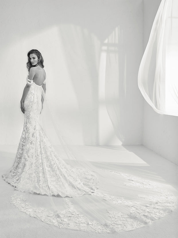 Lace mermaid style strapless wedding dress with cape.