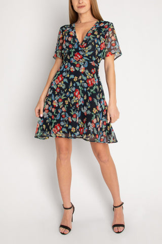 Wrap Mini Dress In Tropical Floral Black