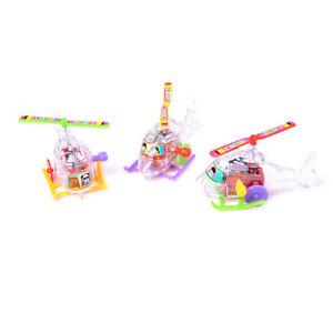 2Pcs Mini Clockwork Transparent Aircraft Somersault Running Wind Up Toy LA
