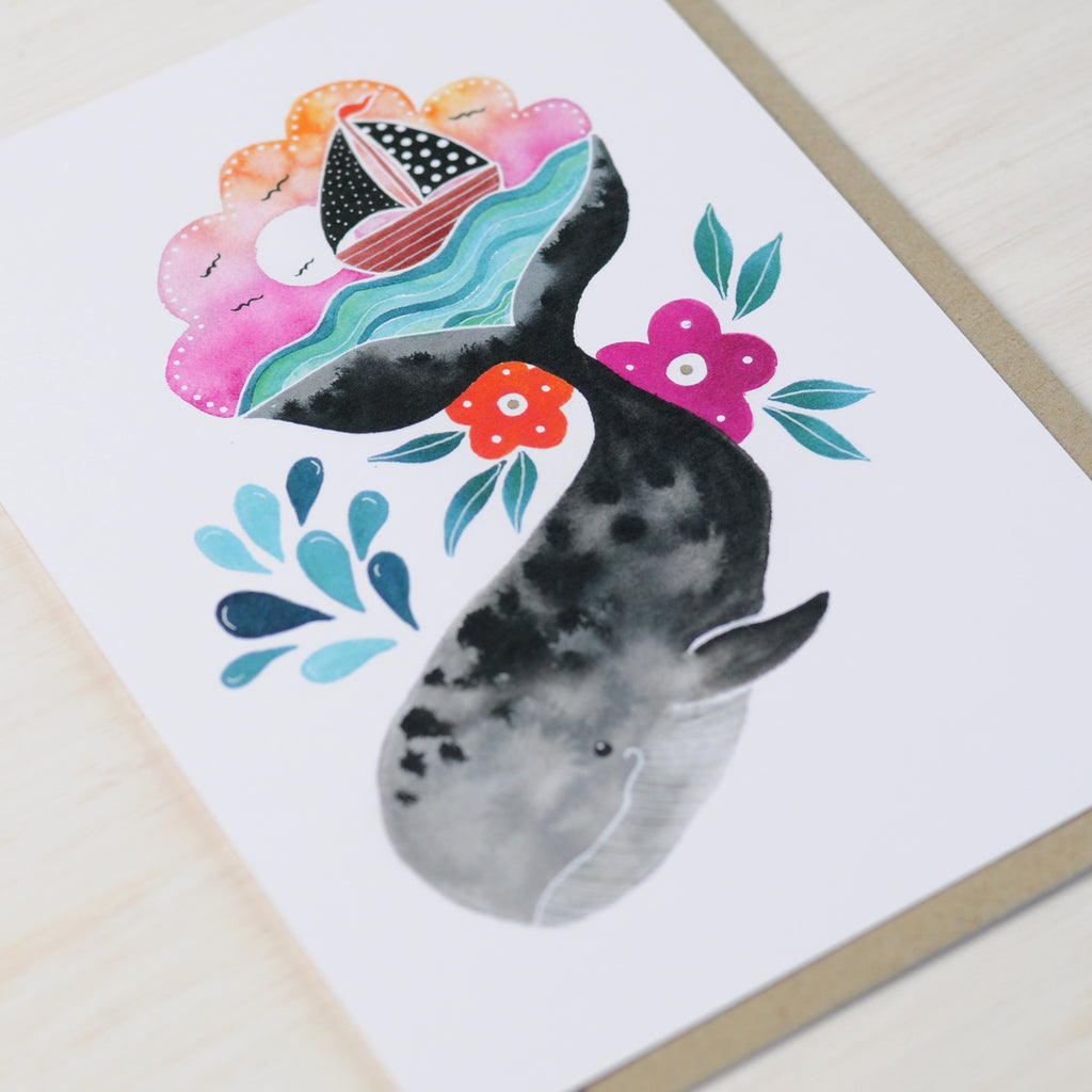 Greeting card featuring cute whale illustration